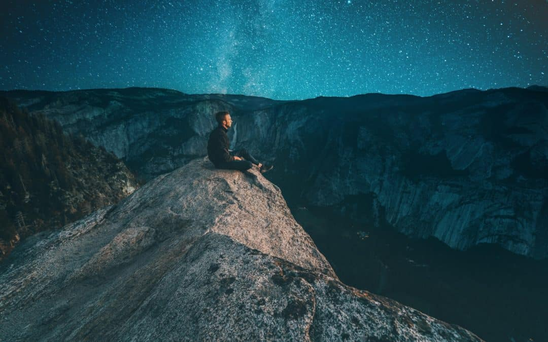Man sitting on the rock at night