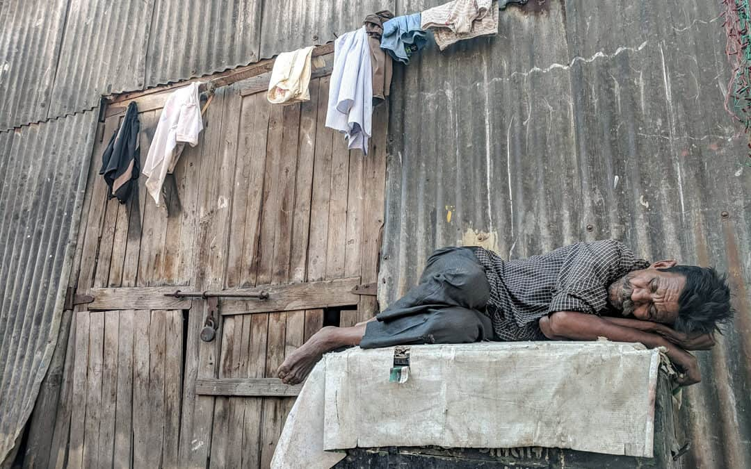 Man sleeping outside the building