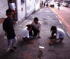 children playing together on the sidewalk