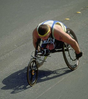 Man  in wheelchair competing in race