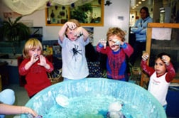 Photo of children playing with big bowl
