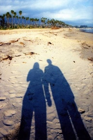 Photo of shadow couple on sand
