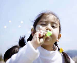 Photo of a girl blowing bubbles