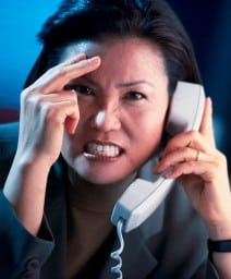 Photo of angry woman on the phone